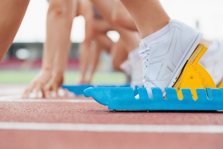 15589874 - athletic starting block with runners on track