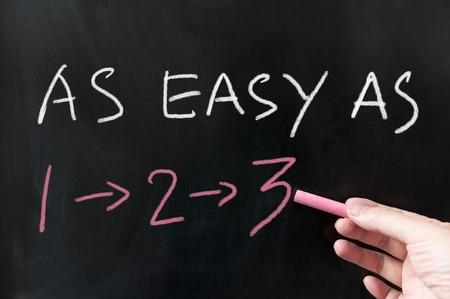 42308425 - as easy as 123 words written on the blackboard using chalk